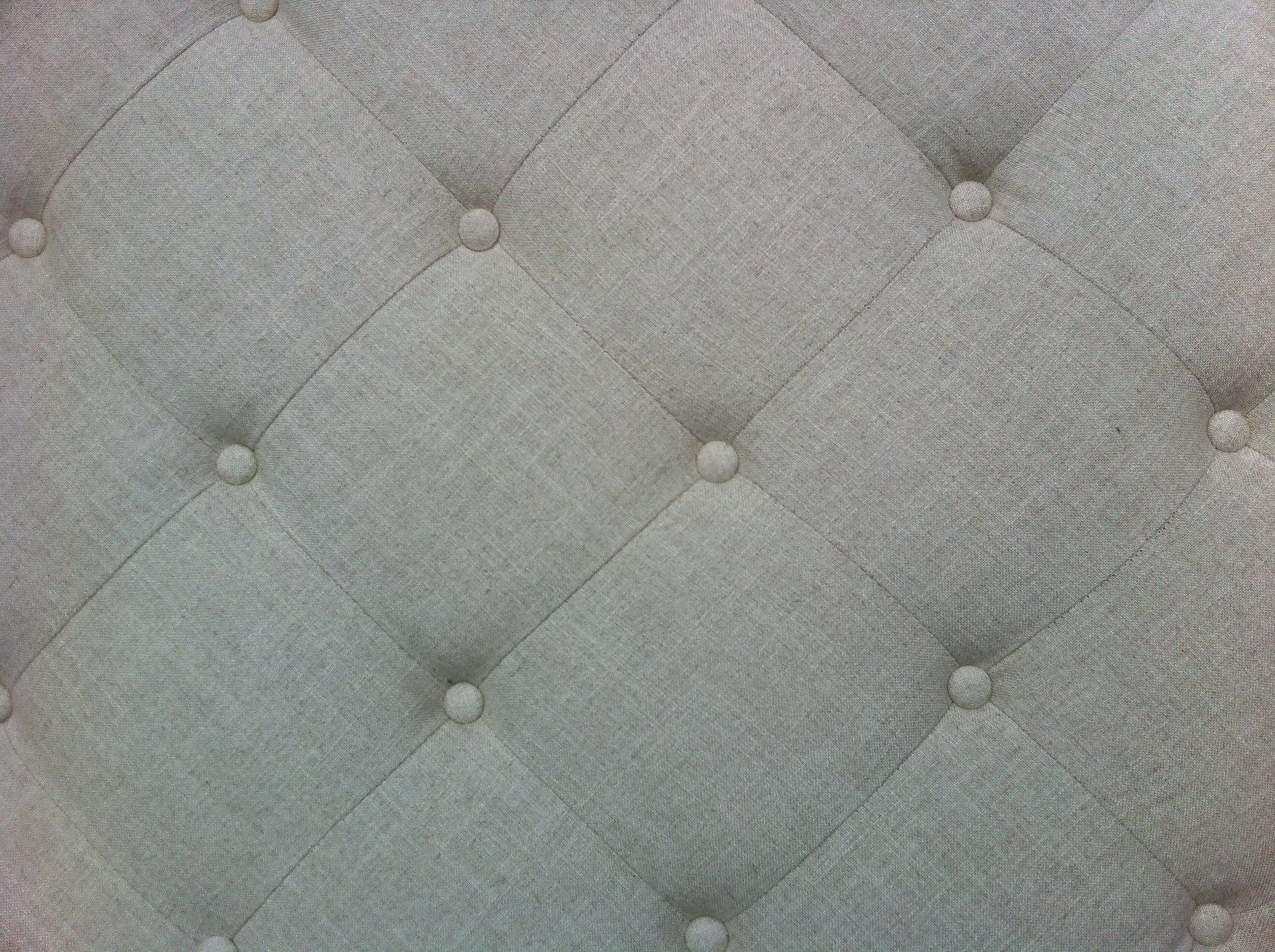 A tight shot of ottoman light colored fabric