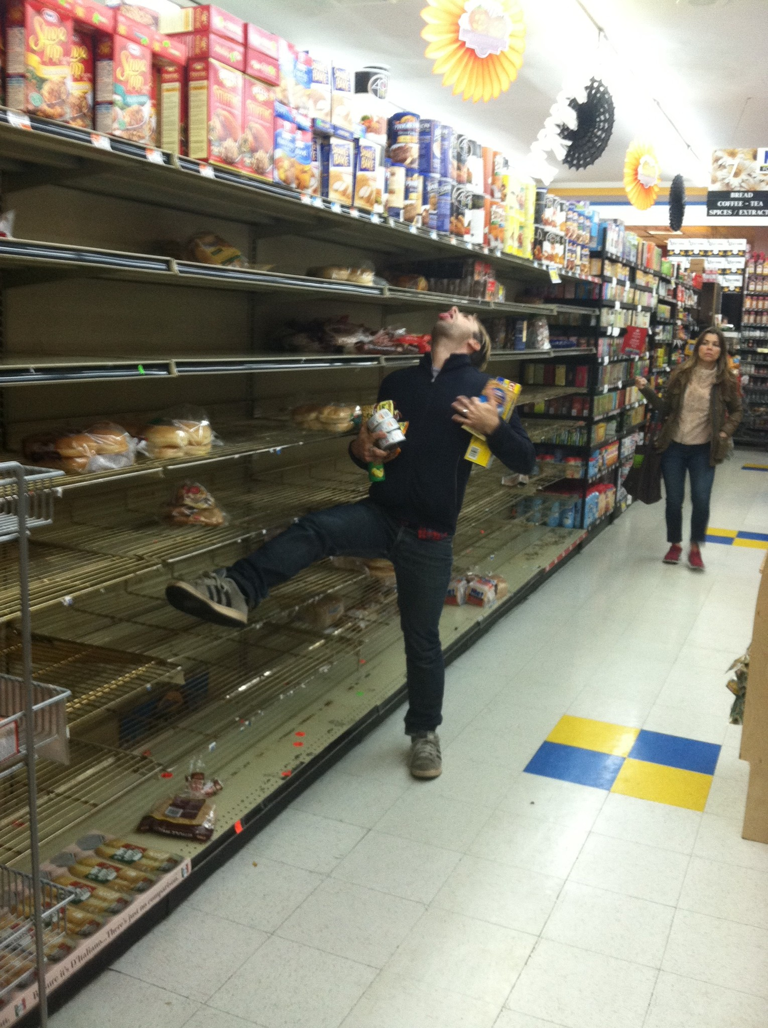 A pic of PJ Mehaffey in the empty bread aisle at a grocery store