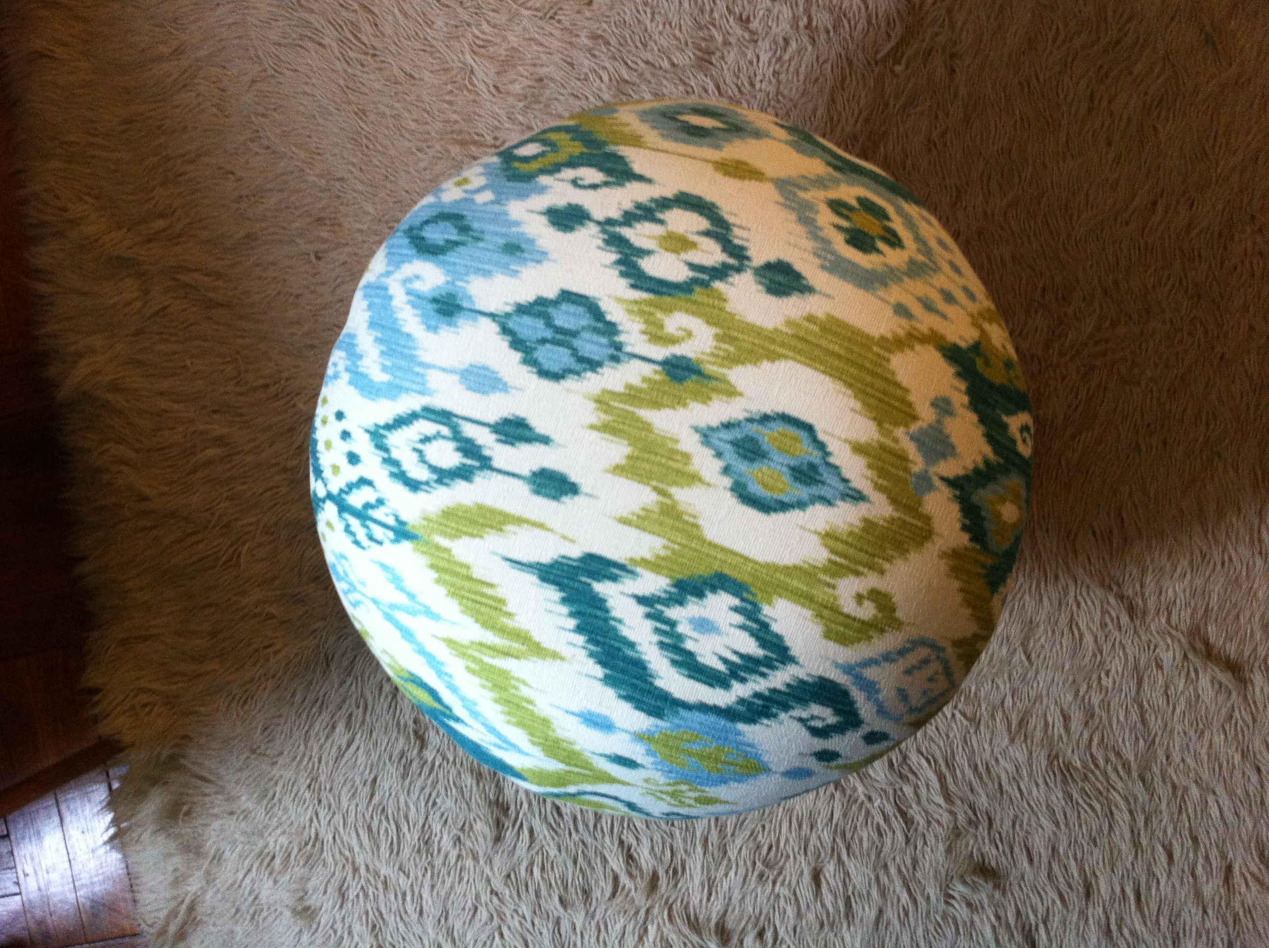 An overhead shot of upholstered mushroom ottoman
