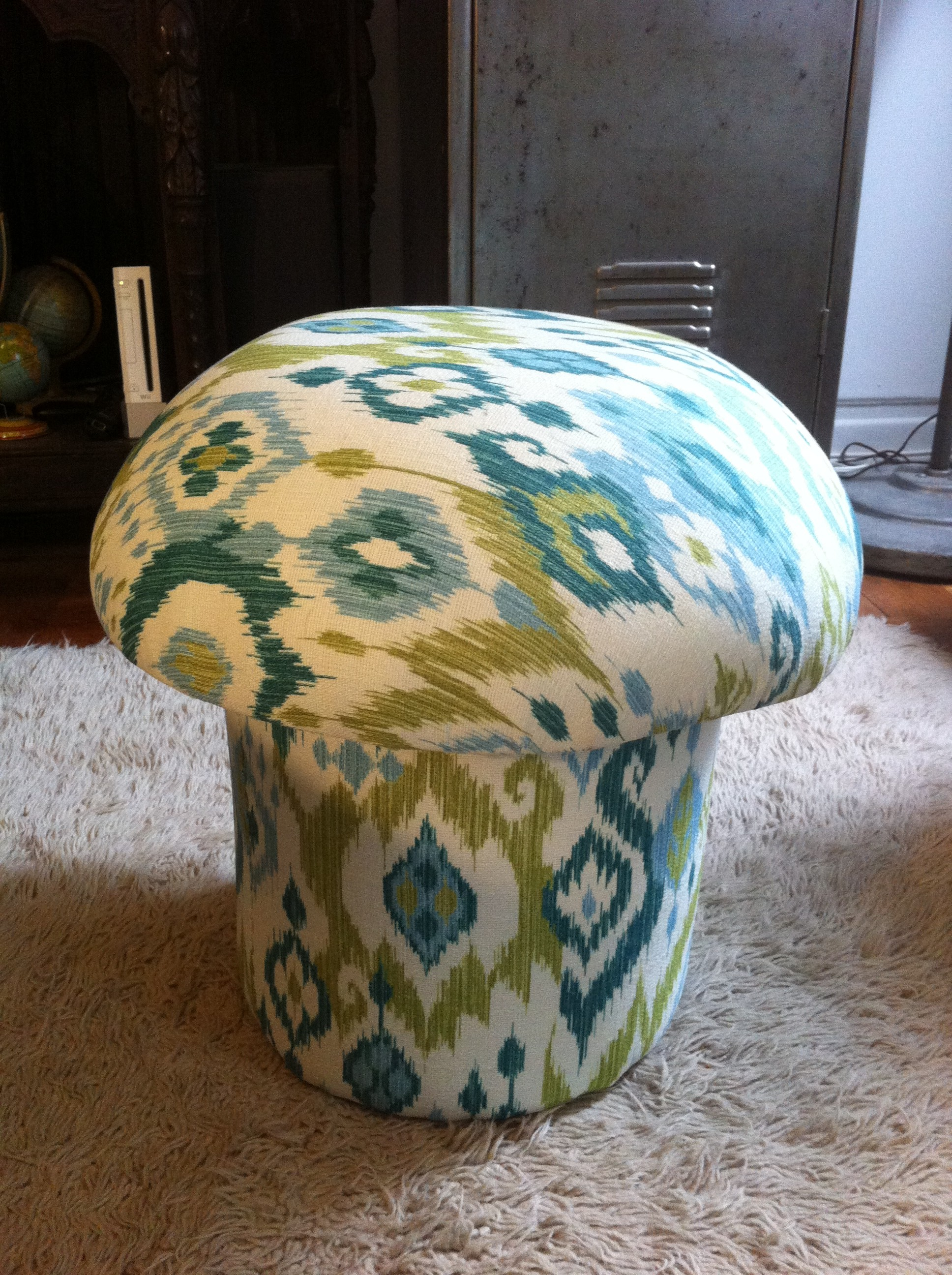 A pic of reupholstered mushroom ottoman