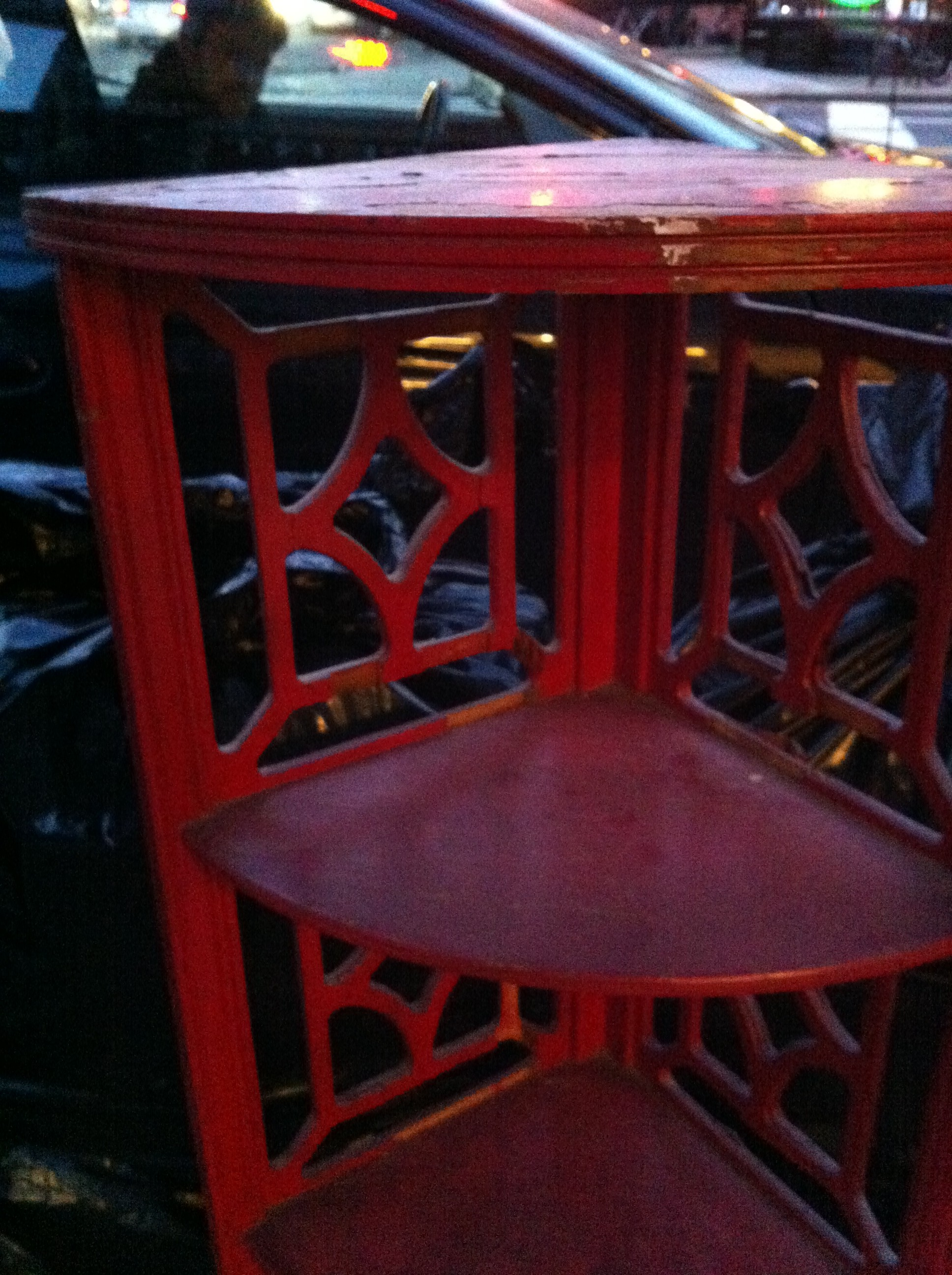 A close up shot of the red corner shelf unit left out on NYC street