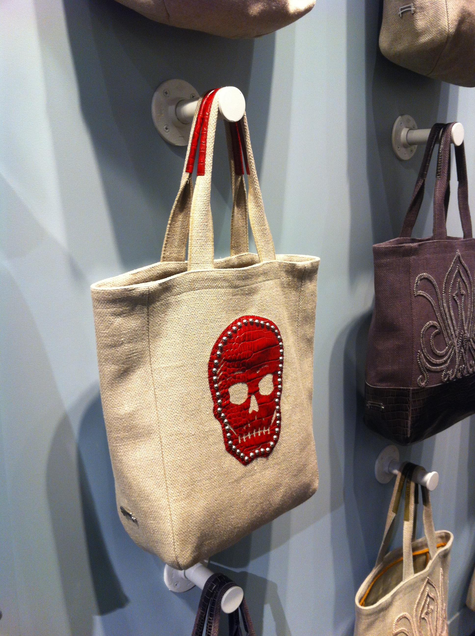 A tight shot of an Ankasa canvas tote bag with red skull