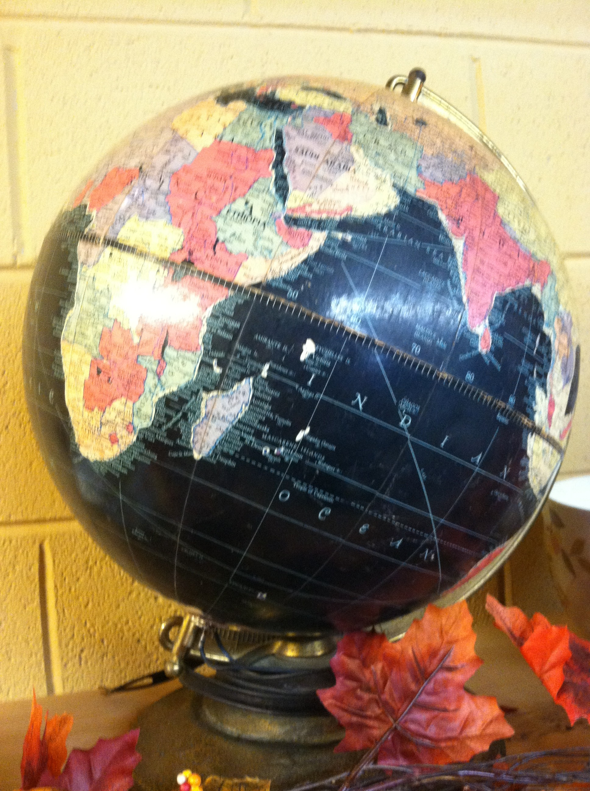 A pic of a black world globe in a Tennessee thrift store