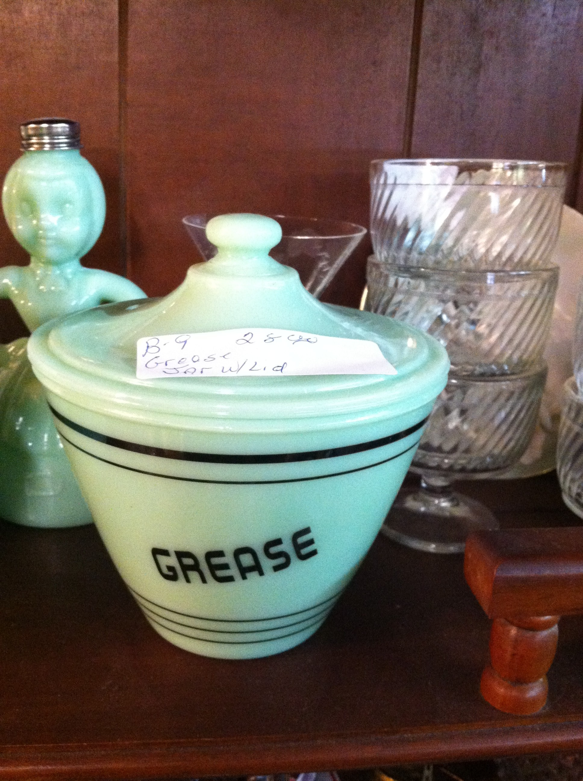 A tight shot of jadeite Grease jar from Tennessee thrift shop