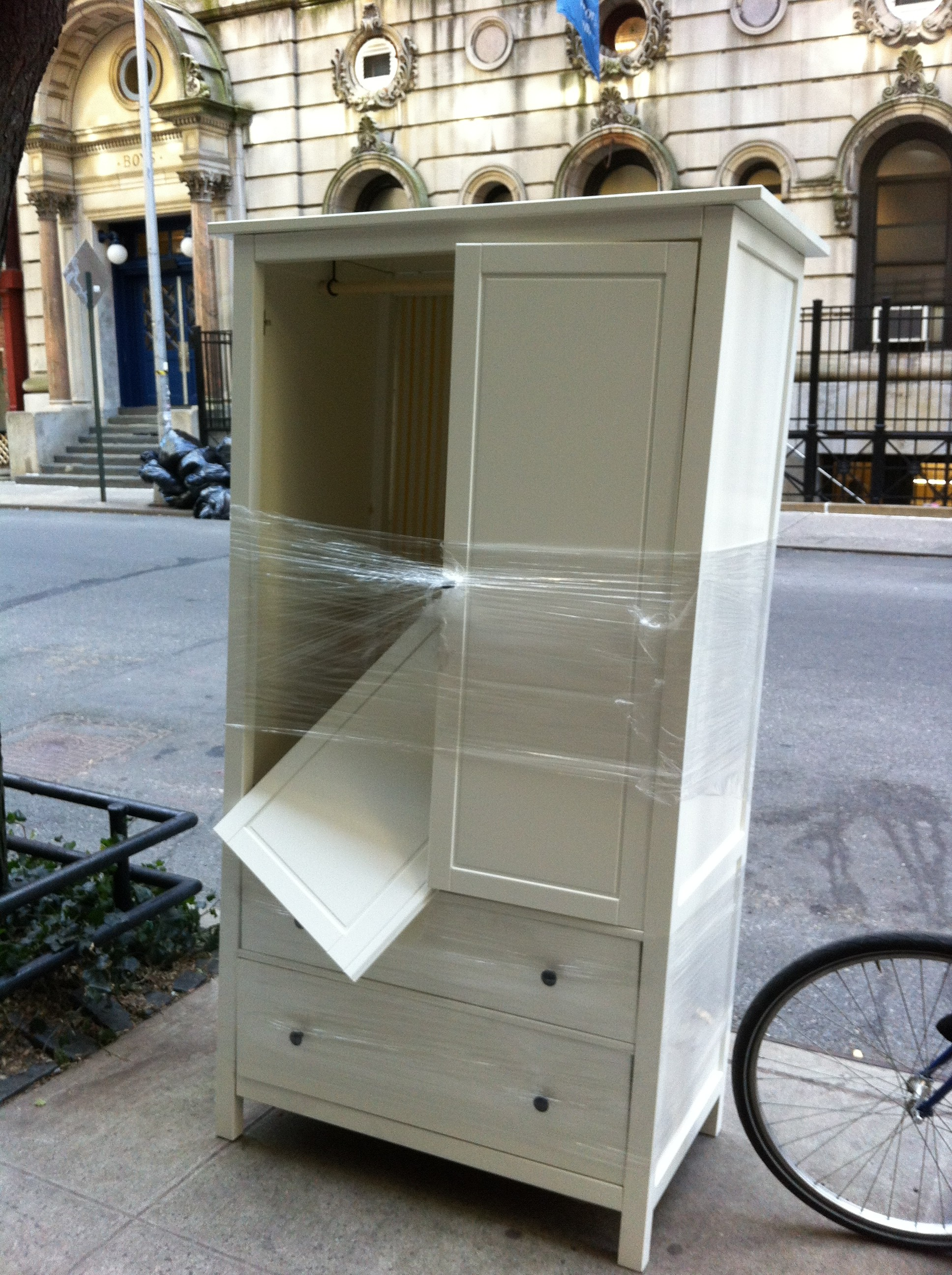 A pic of a FREE white armoire on NYC street