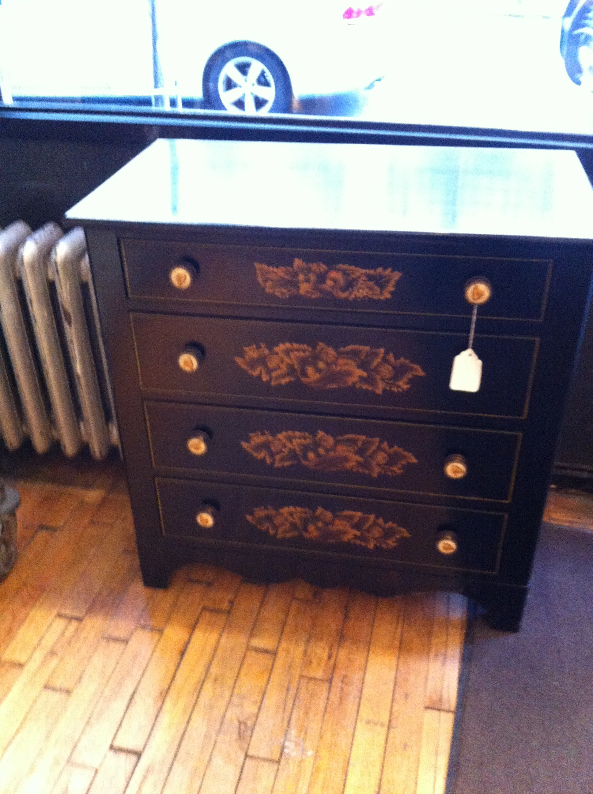 Pic of a small black dresser at Angel Street thrift