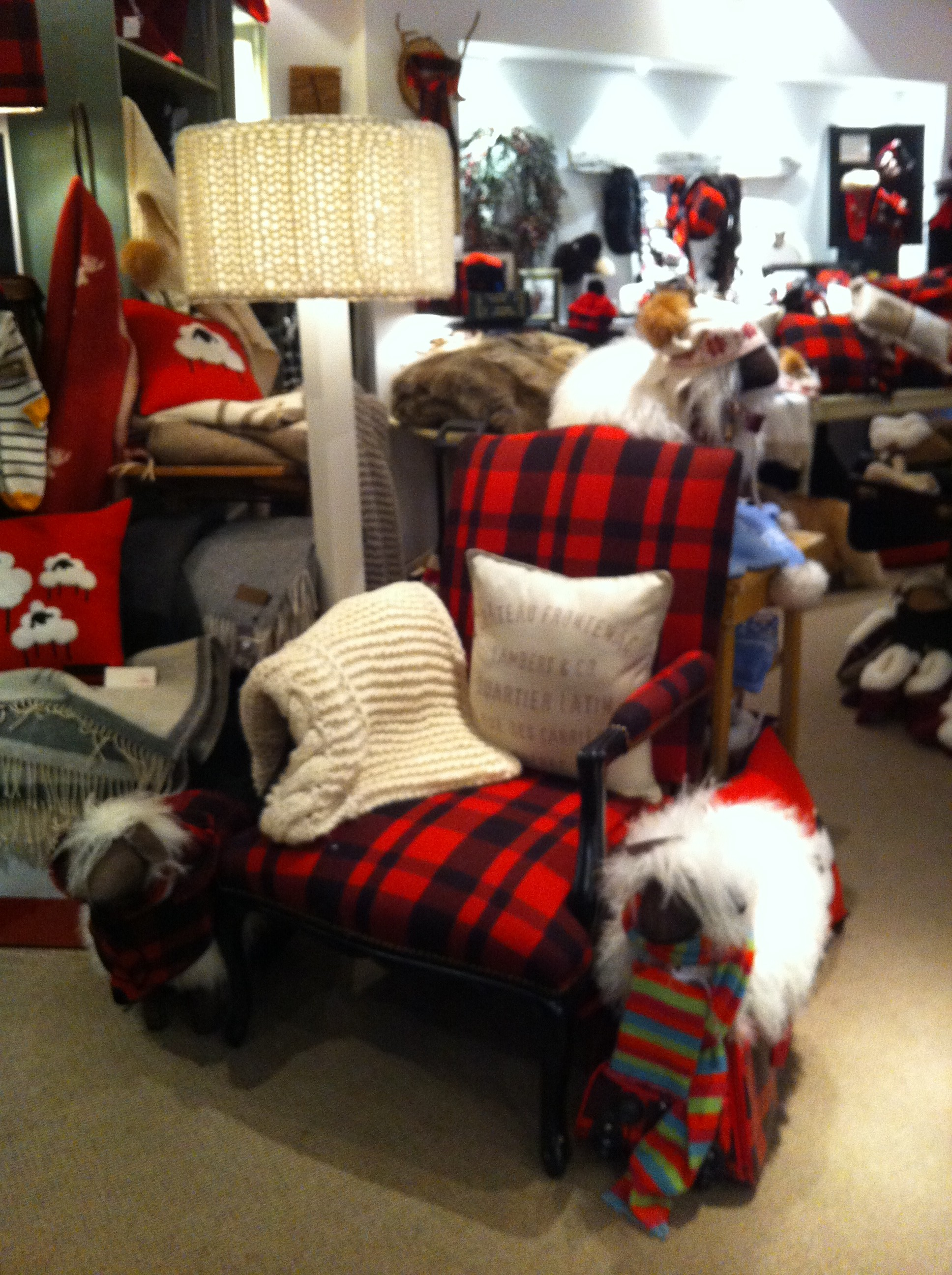 A pic of an armchair upholstered in red buffalo plaid at Lambert & Co