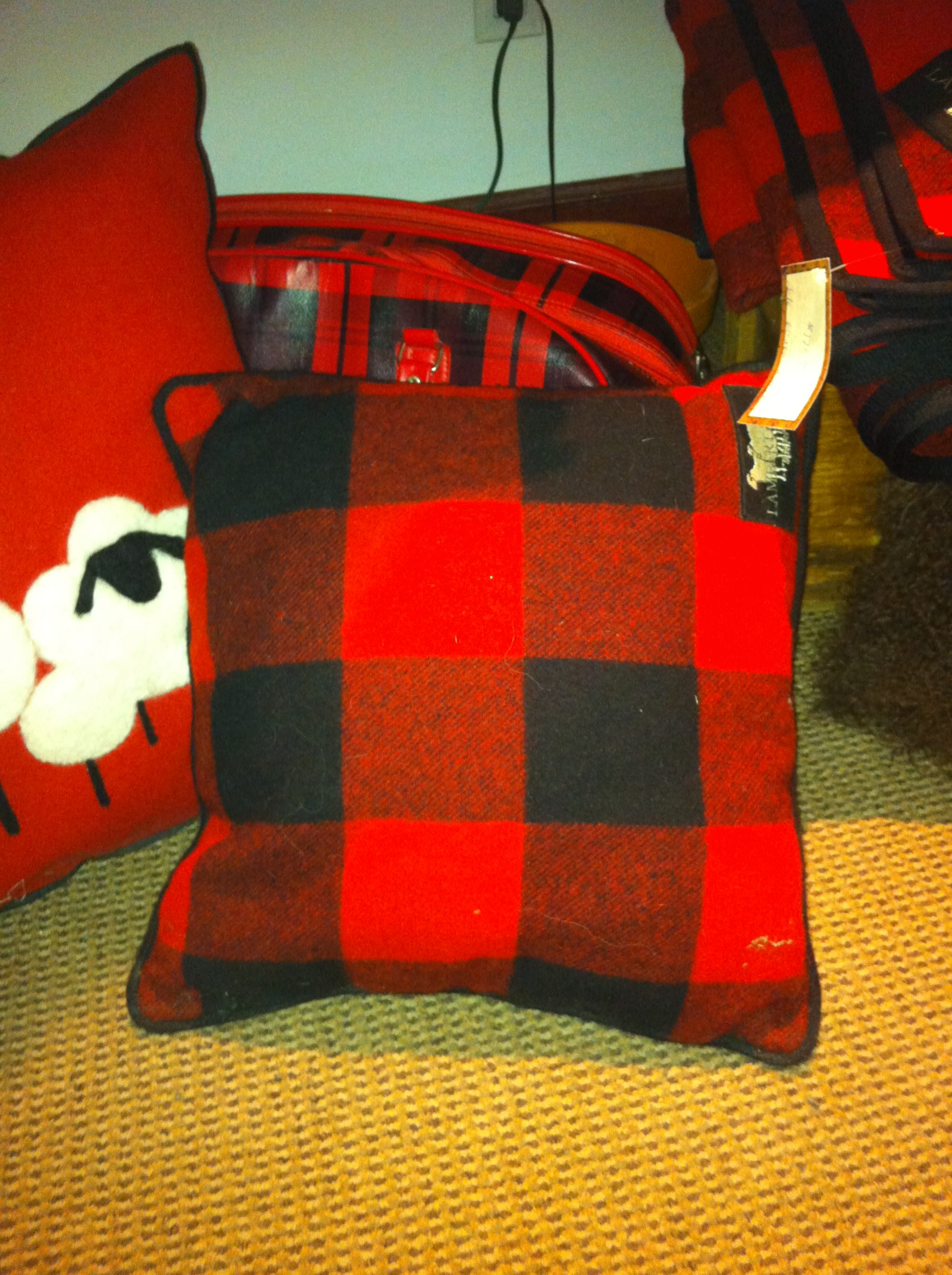 A red buffalo plaid throw pillow at Lambert & Co