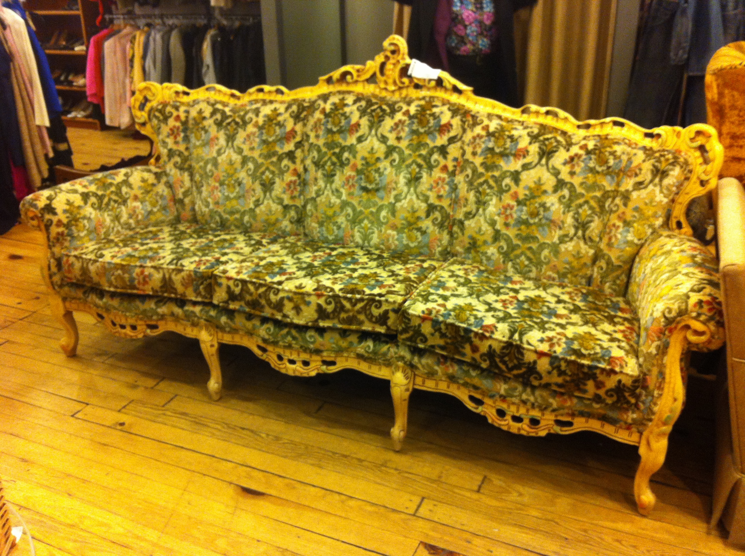 A pic of an ornate, Rococo style sofa at Housing Works