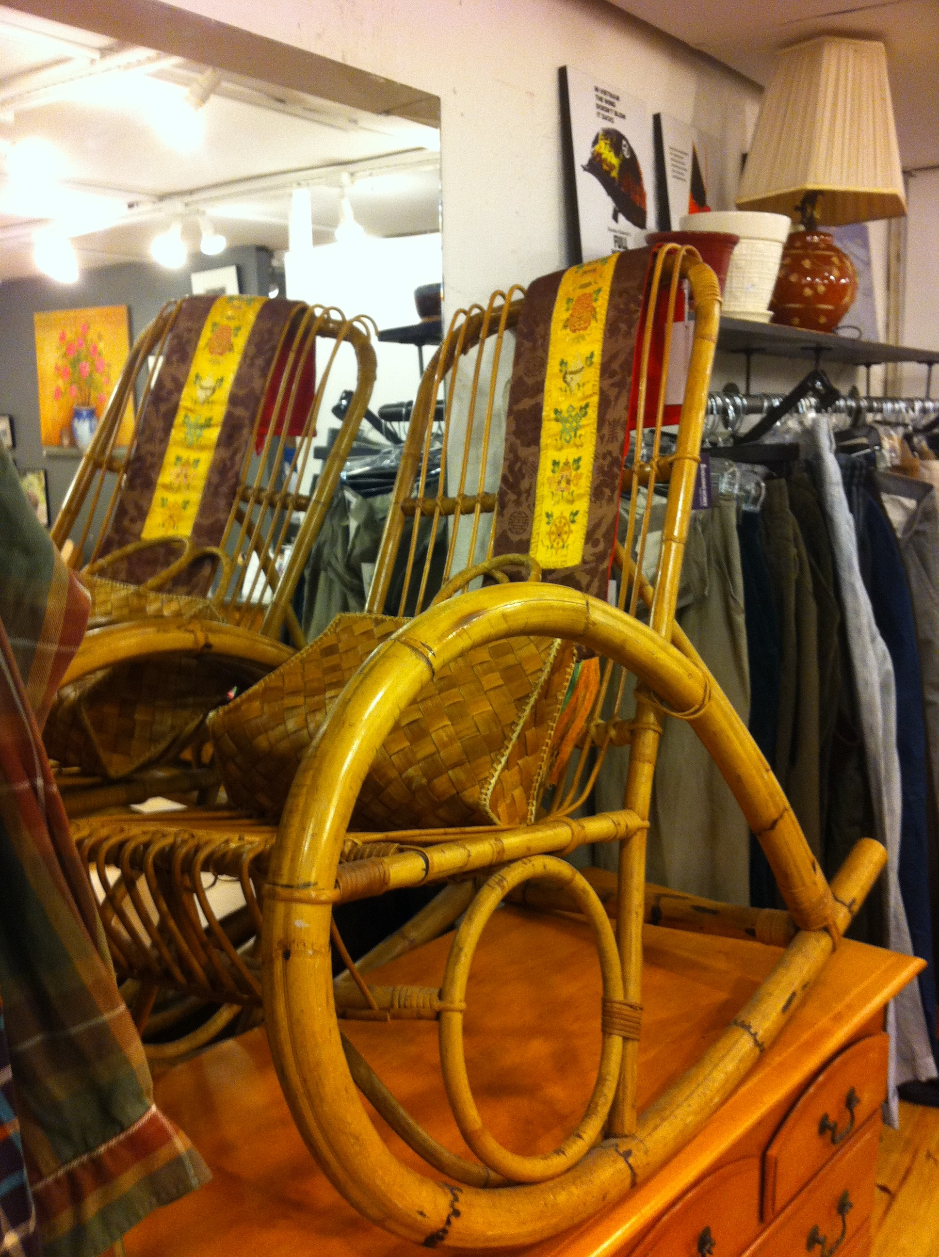 A pic of a bamboo rocking chair at thrift store