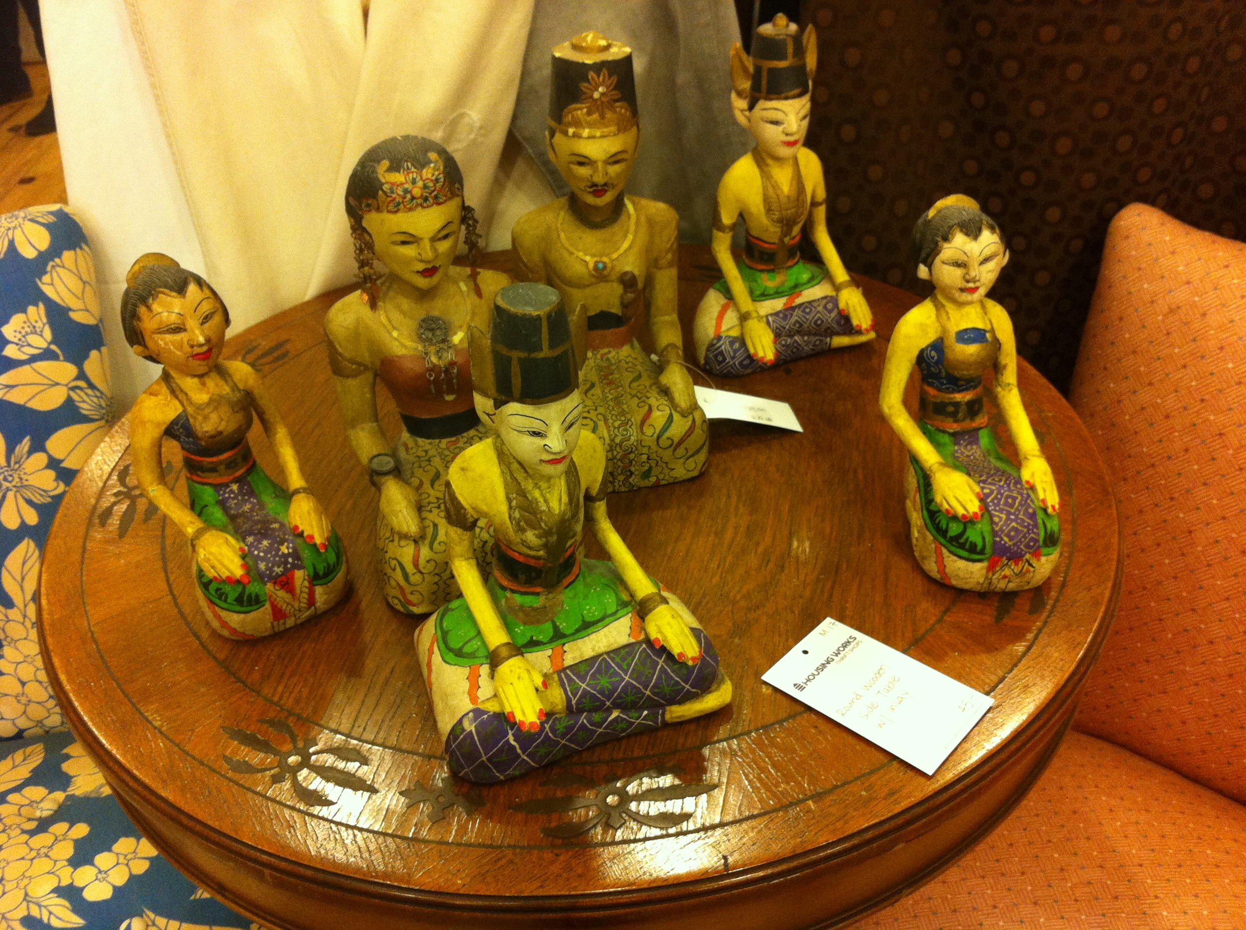 A pic of wooden statues in thrift store