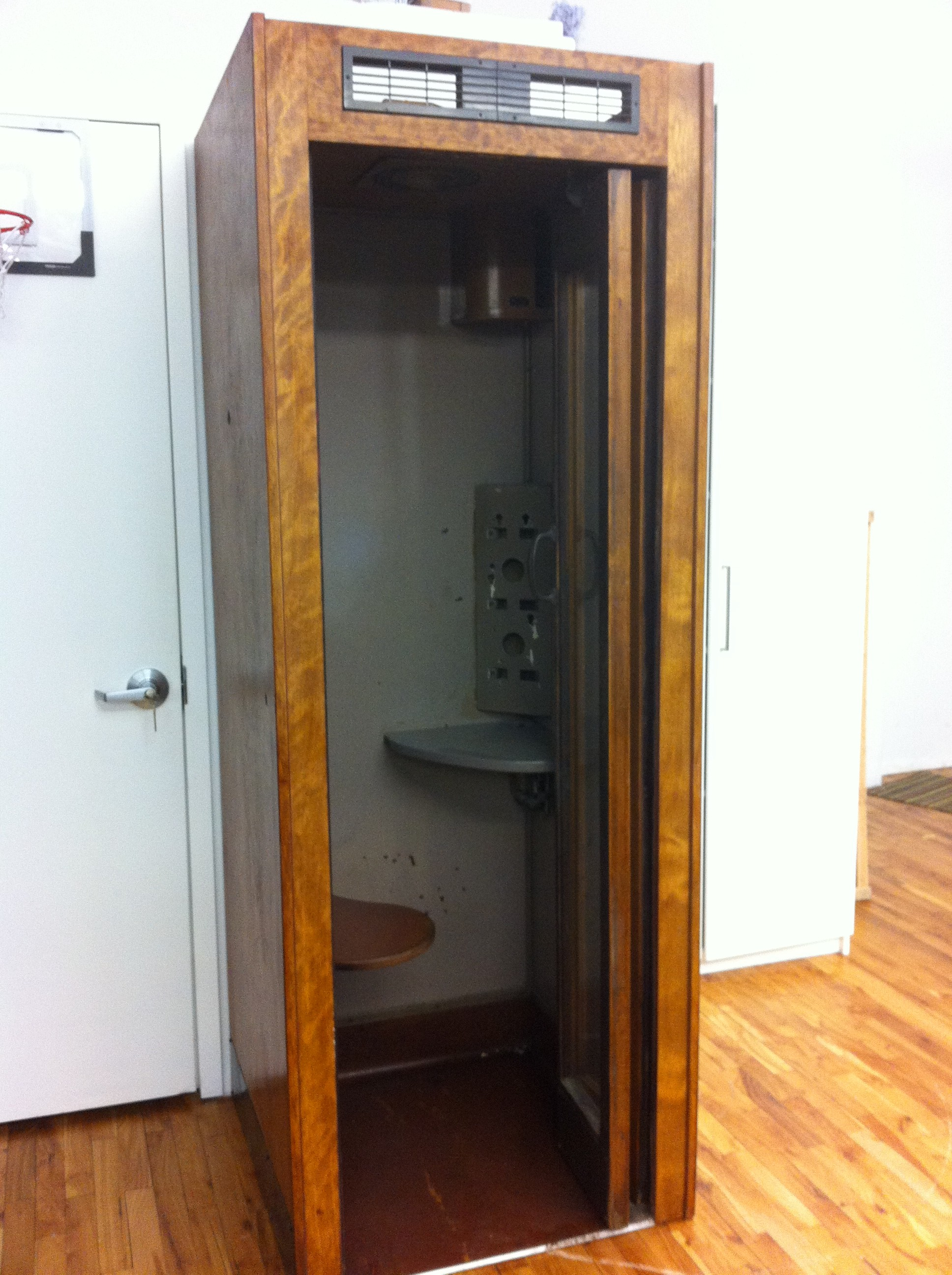 A pic of vintage phone booth with door open