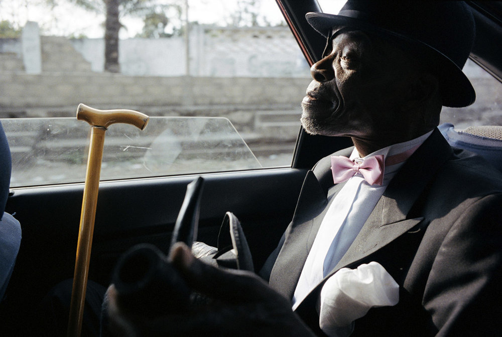 LE PARISIEN KIBOBA (the Old Parisian) in a taxi