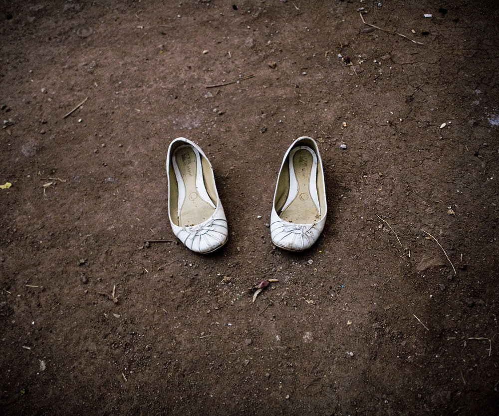 A PAIR OF SHOES AND 10 CHILDREN