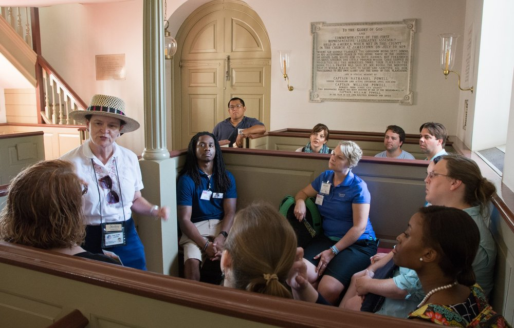 A tour guide shares with BJC Fellows about Bruton Parish Church. Like our group photographed here, parishioners sat in boxed pews, their walls providing privacy and protection from the elements.