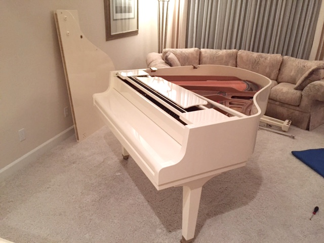 Baby Grand Piano being disassembled