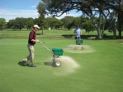 Top dressing at another course (image via superintendentmagazine.com)