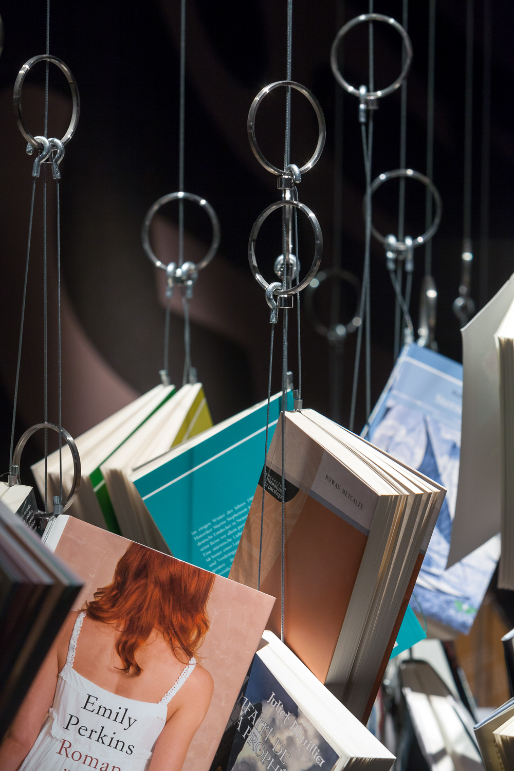 Books related to the current topics are clustered around the space on book chandeliers. Electronic filing and GPS tracking allows one to easily find the books they are looking for.  Jo designed these book chandeliers for the New Zealand Pavilion at the Frankfurt Bookfair for Patterson Associates.
