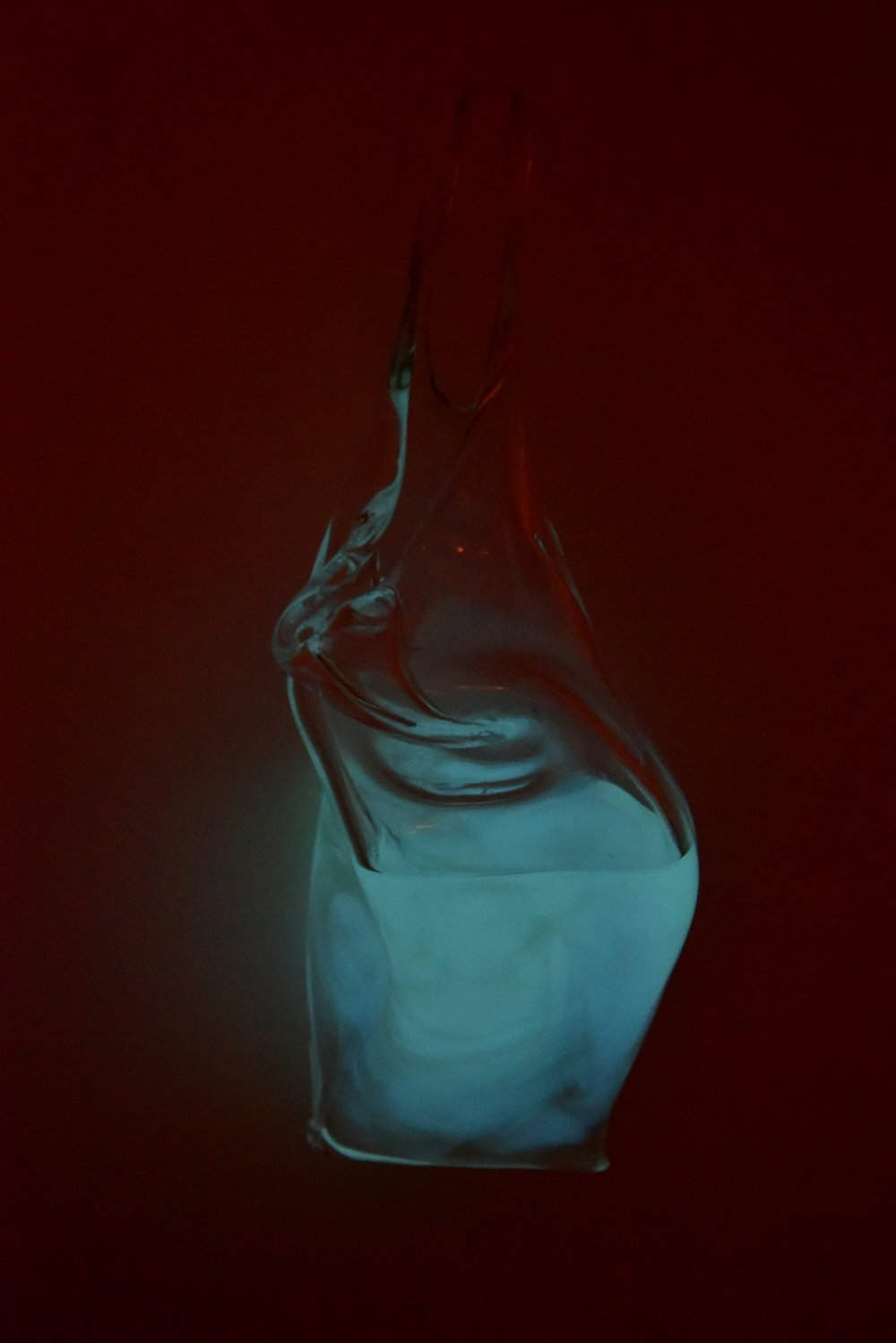 Living light installation - bioluminescent bacteria encapsulated in a beautiful glass creation by Isaac Katzoff.