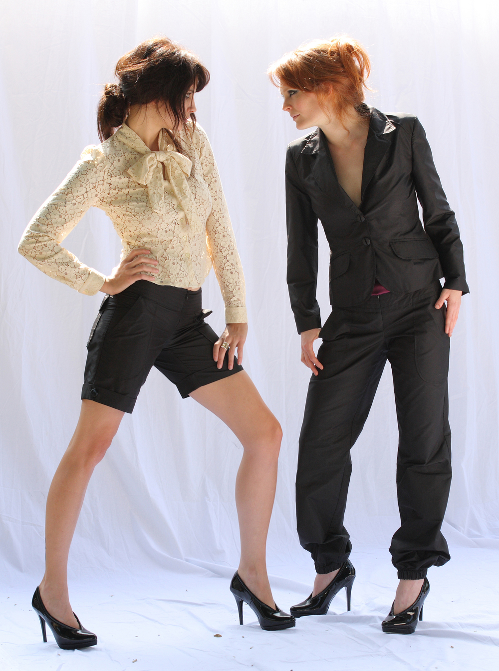 Scarf-Tied Blouse in Flower Lace  Quilt Waist 4-Pocket Cuffed Short in Black Silk Taffetta   On the right   Shrunken Tux Jacket in Black Silk Taffetta  Quilt Waist G.A. Harem Pant in Black Silk Taffeta