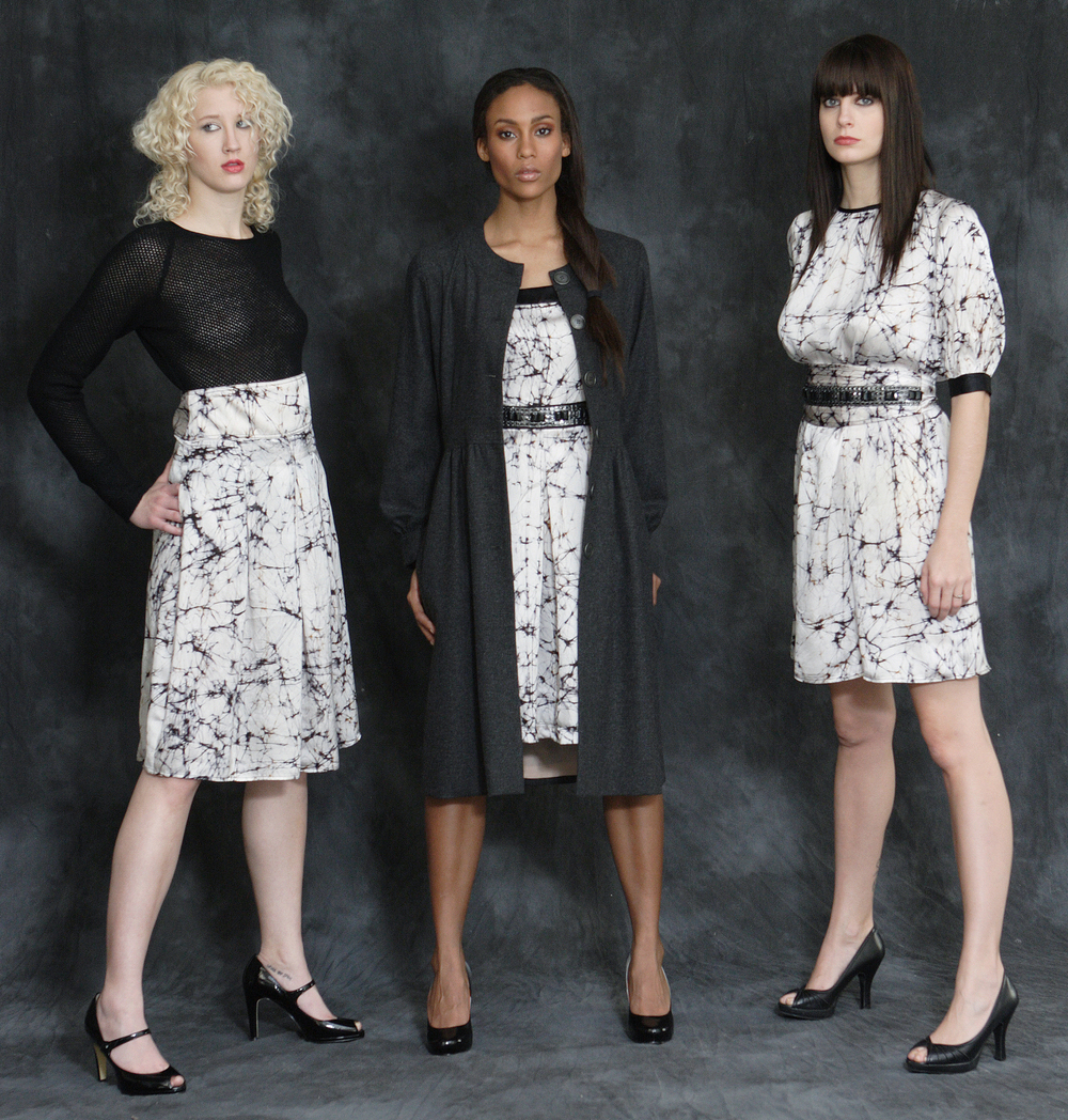From left to right:   Wool Cashmere Raglan Sweater.  Web Print Silk Charmeuse High Waist Pleat Skirt.     Wool Flannel Princess Coat Lined in Silk.  Web Print Silk Chami Dress w/ Patent Straps & Jeweled Waist.                                    Web Print Silk Charmeuse Full.   Cut Sheet Dress w/ Jeweled Obi Belt.