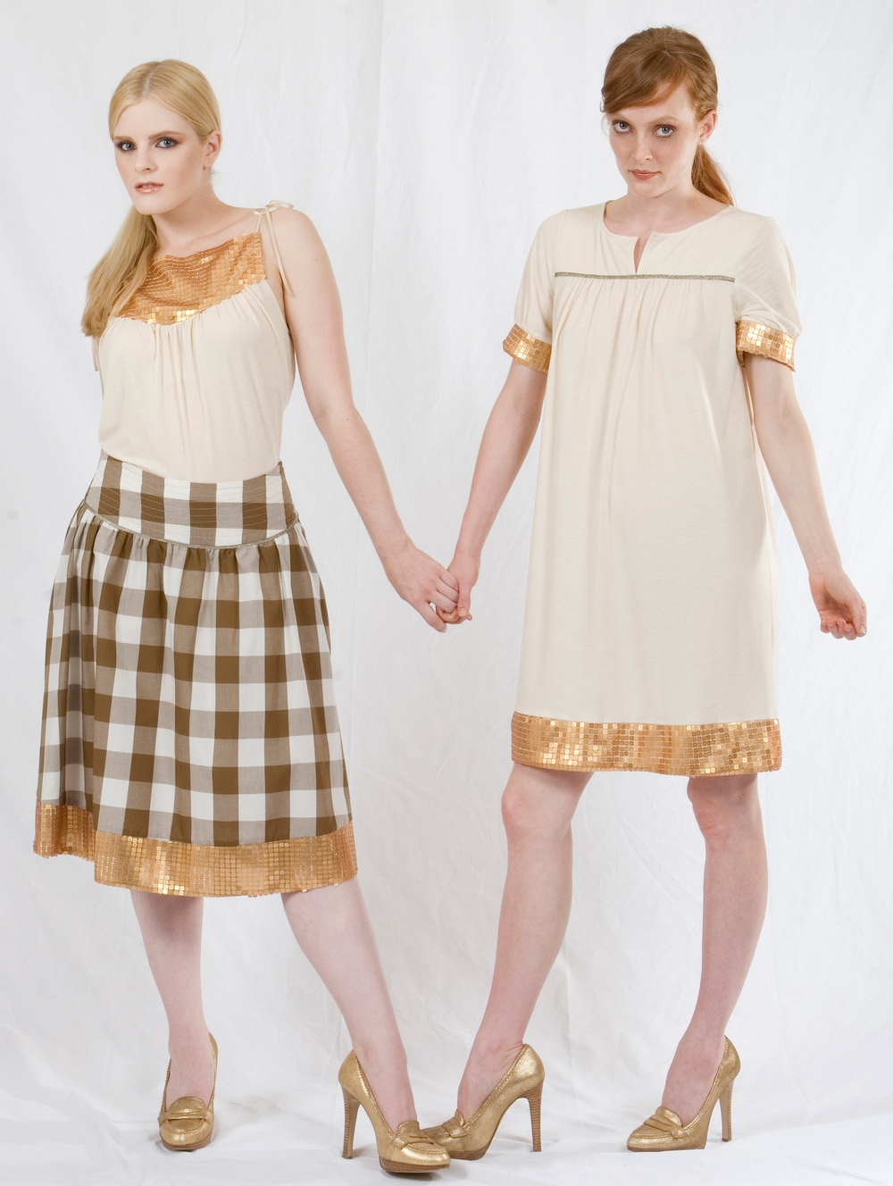 Triangle Top in Ecru Jersey w/ Gold Sequined Yoke & Faux Leater Ties.  Full-Yoke Skirt in Cotton Gingham w/ Gold Sequined Hem & Metallic Trim   On the right:   Edie Dress in Ecru Jersey w/ Gold Sequined Hem & Sleeve Bands & Metallic Trim.