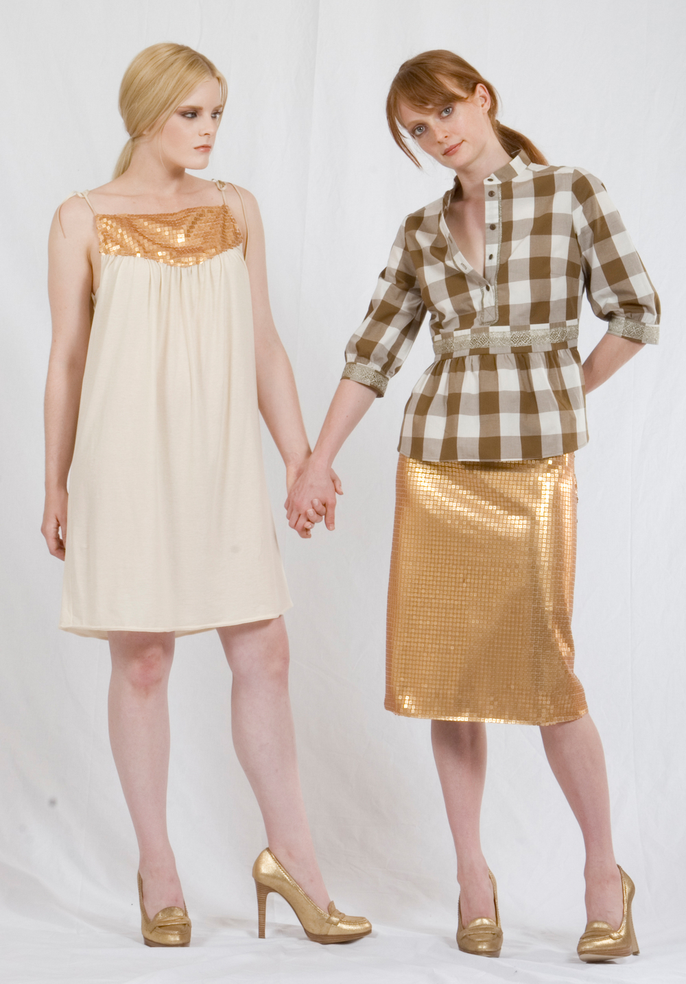 Triangle Dress in Ecru Jerseyw/ Gold Sequined Yoke & Faux Leather Ties.   On the right:   Banded Tunic Shirt in Cotton Gingham w/ Metallic Lace Details  A-Line Skirt in Gold Sequined Tulle.
