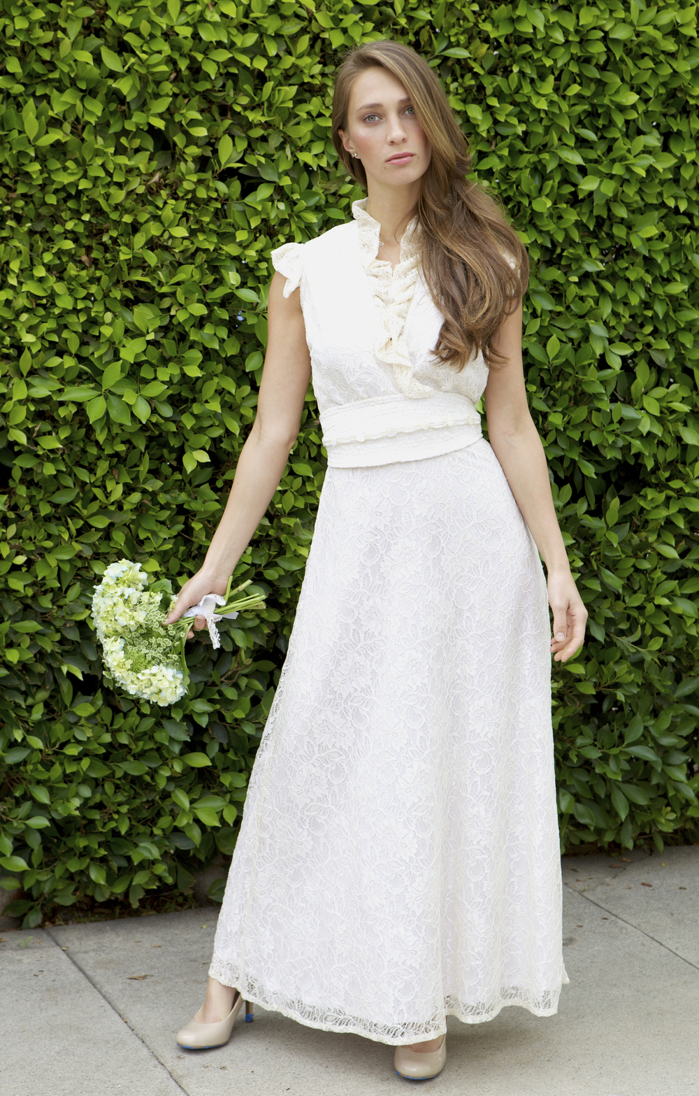 Ruffle edged lace wedding dress with beaded obi belt.