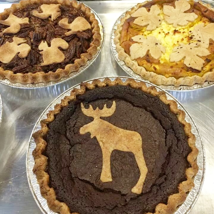 Bourbon maple pecan with squirrel cut outs, Butternut squash curry savory pie, and Chocolate Moose fudge pie