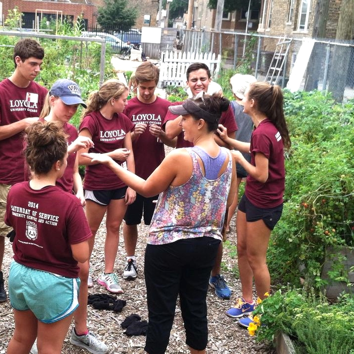 Sarah teaching students about how herbs taste and grow