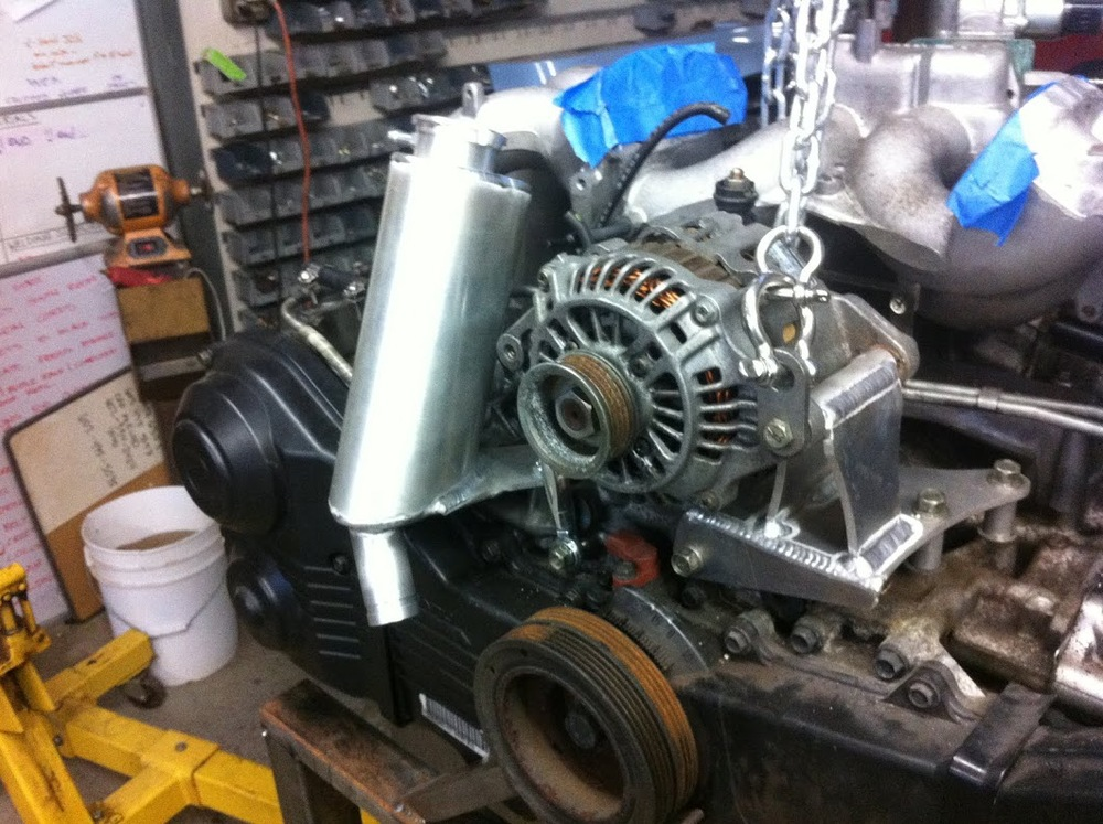 Alternator mount doubles as engine hanger