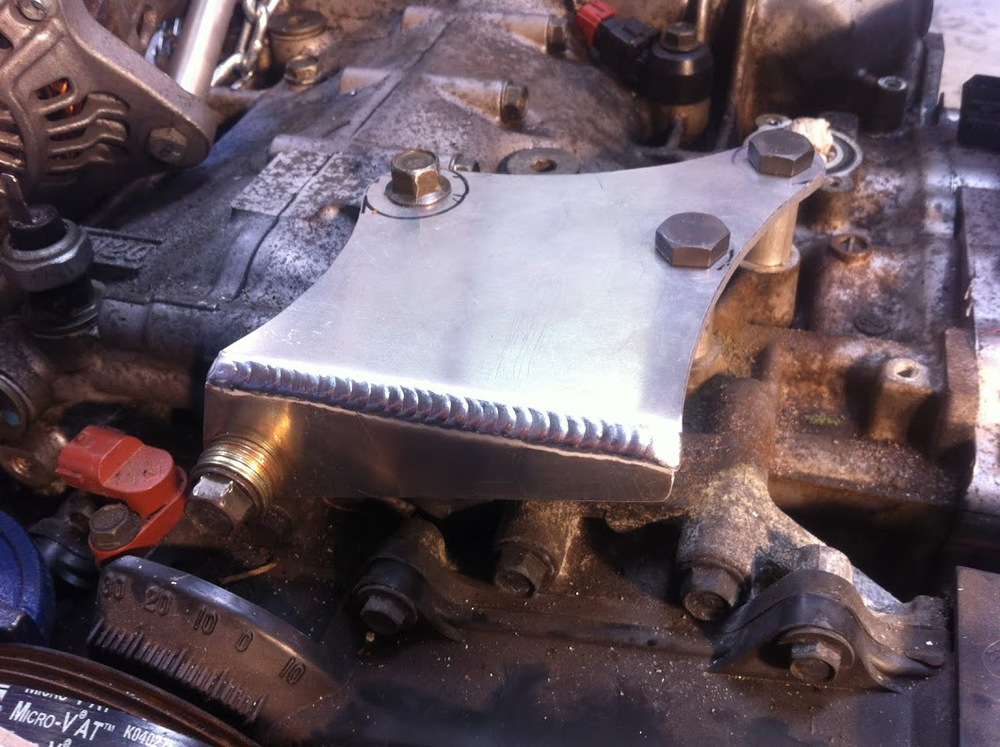 New alternator mount base