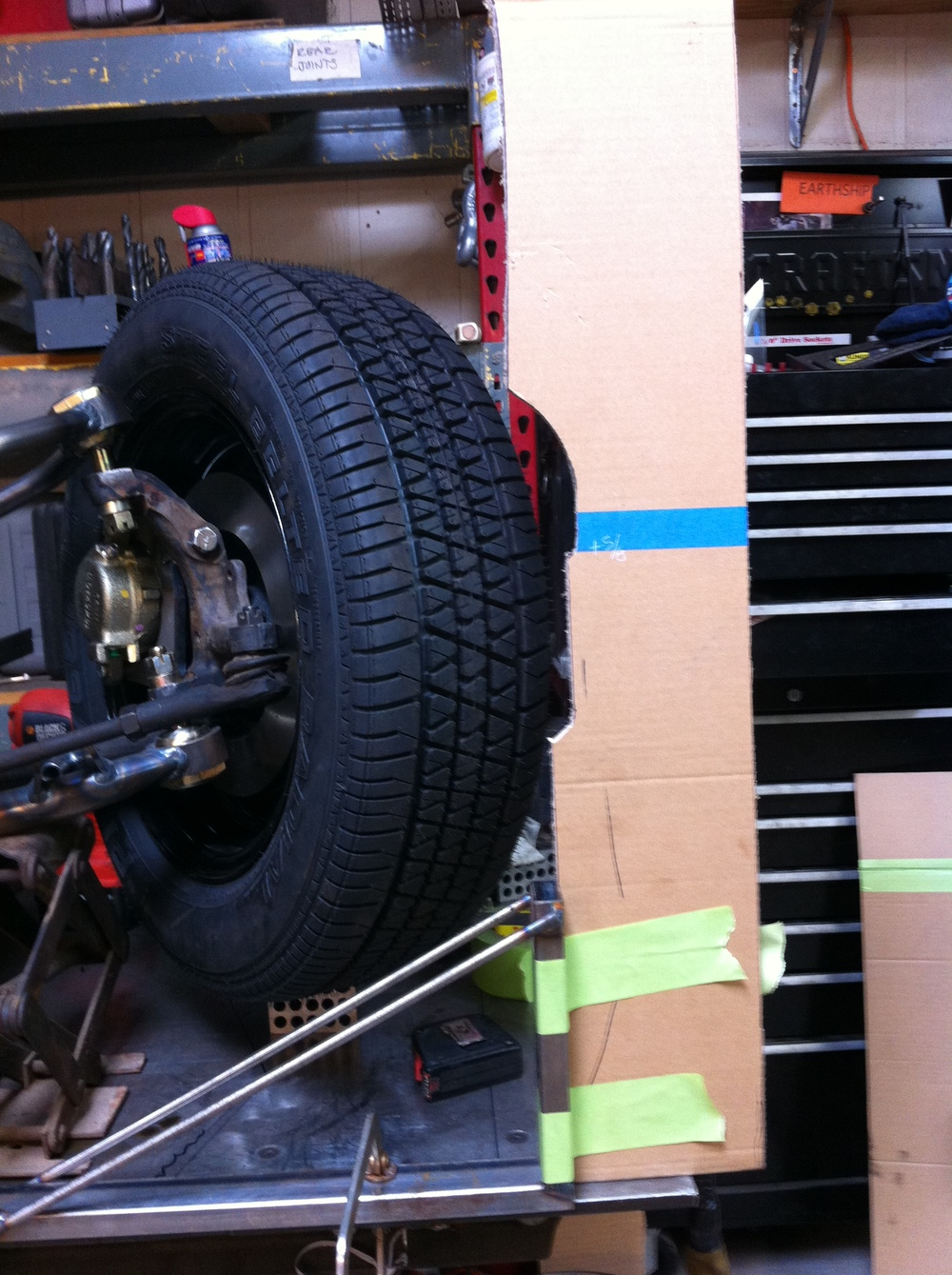 Checking tire clearance with a cardboard fender.JPG