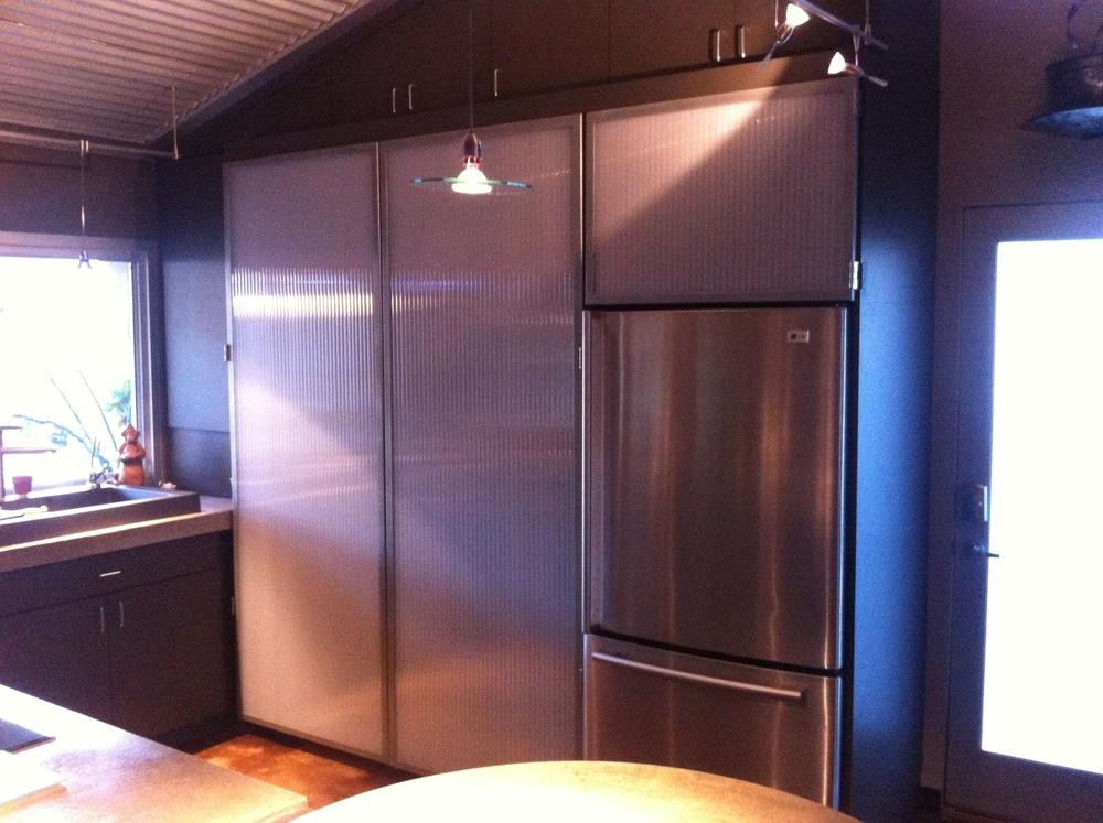 Custom steel and plastic cabinet doors.JPG