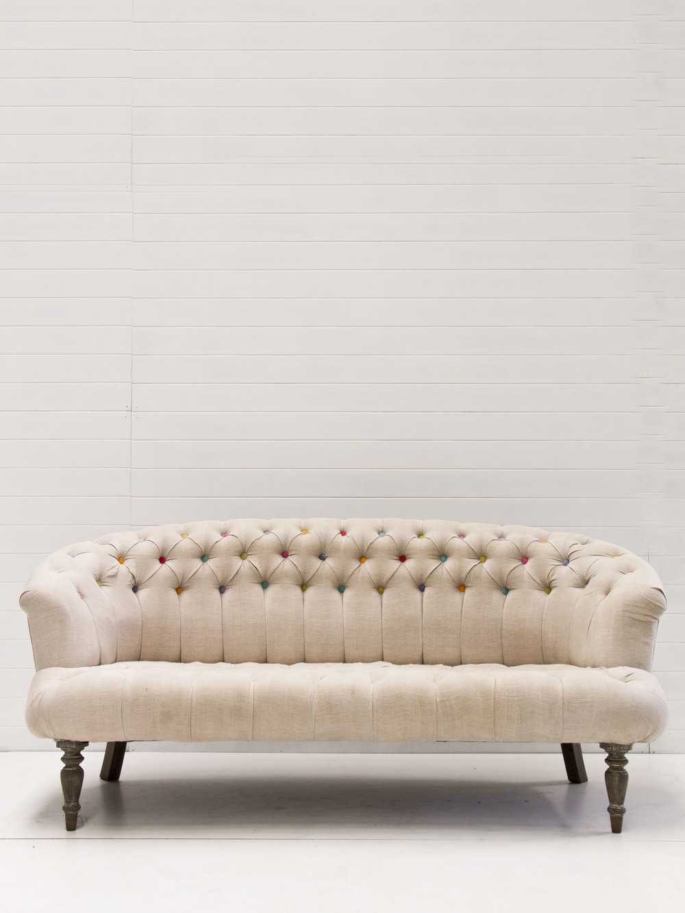 Coloured button tufted sofa.jpg