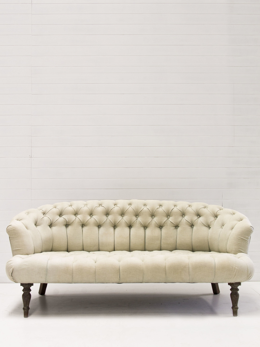 Seafoam button tufted sofa.jpg