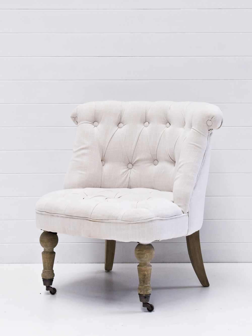 Petite linen tufted armchairs.jpg