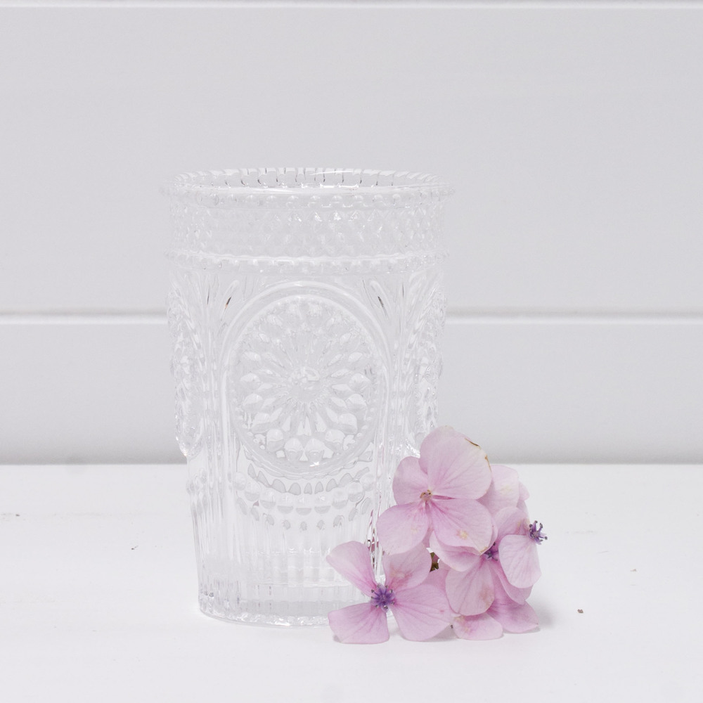 Ornate clear glass tea light holder.jpg