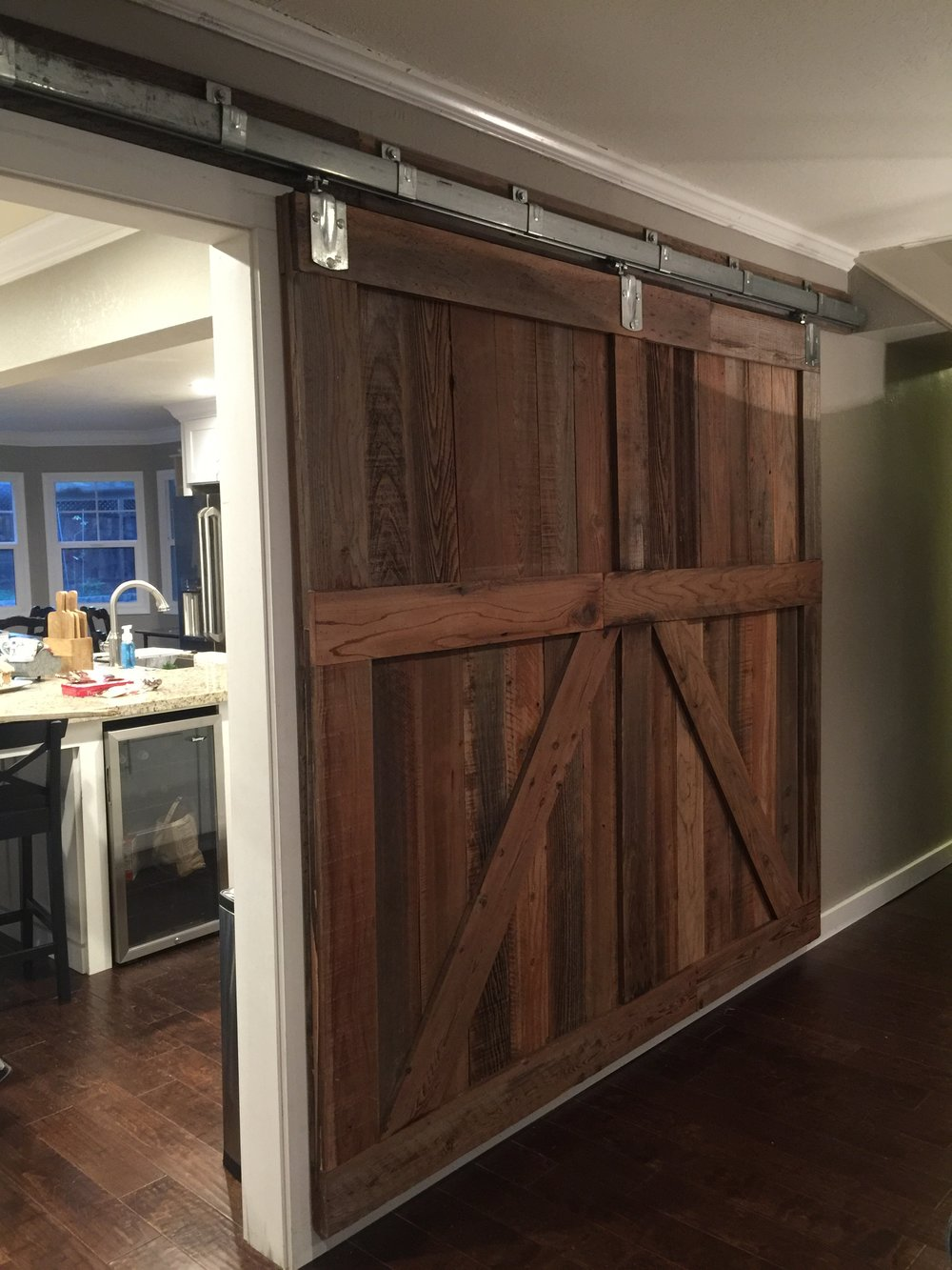 Separate sliding doors in a contemporary farmhouse style home.