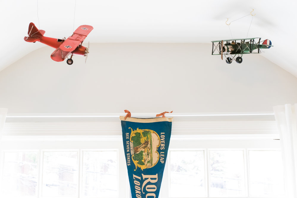 We bought these WWI biplanes to hang in Nuelie's nursery when he was born. Well, that never happened - it only took us six years.