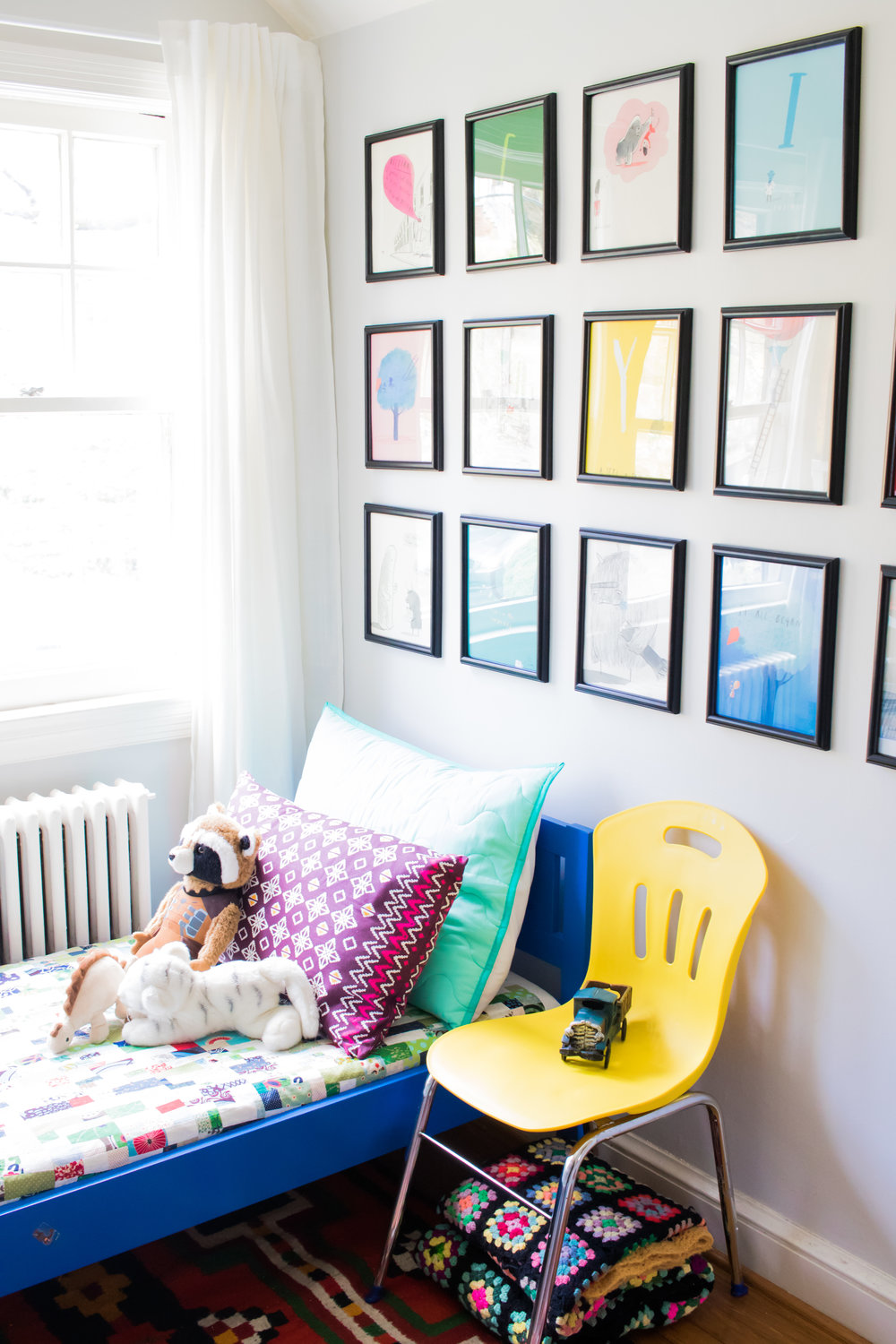 The blue bed is from IKEA, the pillows are from Target and IKEA. I made the quilt, and you can see more about that   here  . The grid of images are pages from Oliver Jeffers' alphabet book.