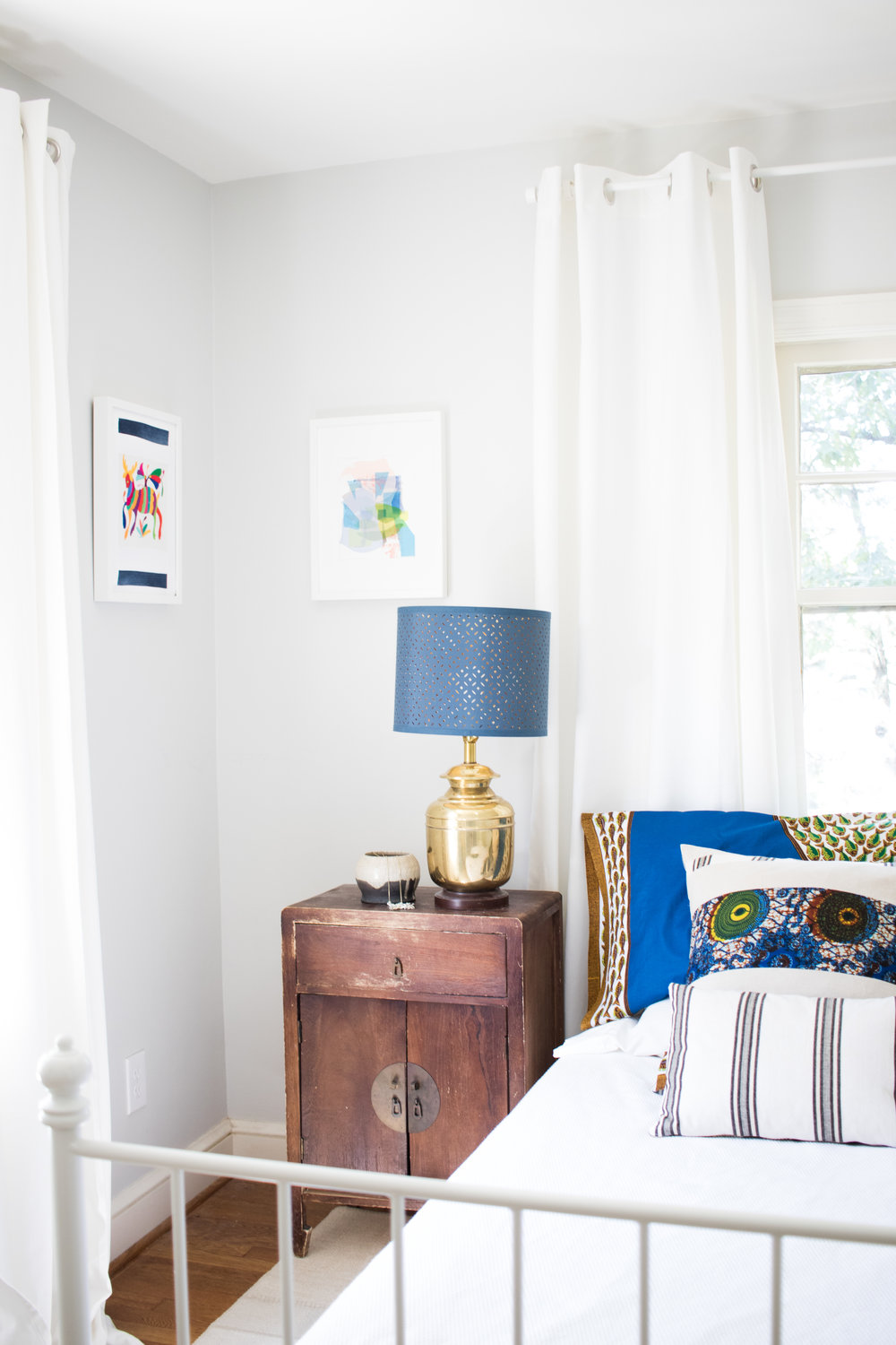 The night stands are from Korea. It's not an antique, but it looks like it from our use!