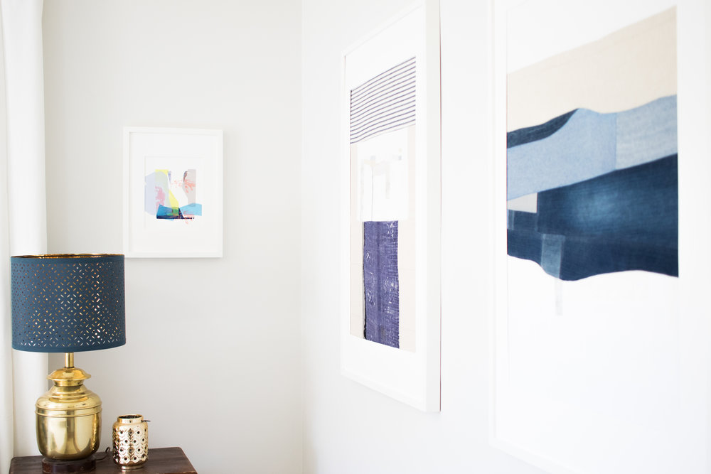 A silkscreen print next to the lamp and two fabric pieces by yours truly.