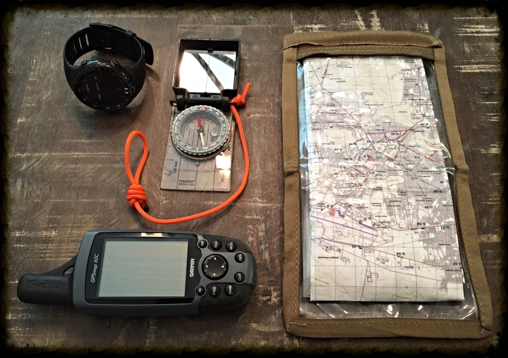 Backcountry navigation using redundancy- Garmin 60C GPS, Suunto core watch with altimeter/compass, area map, Silva compass with protractor and string.