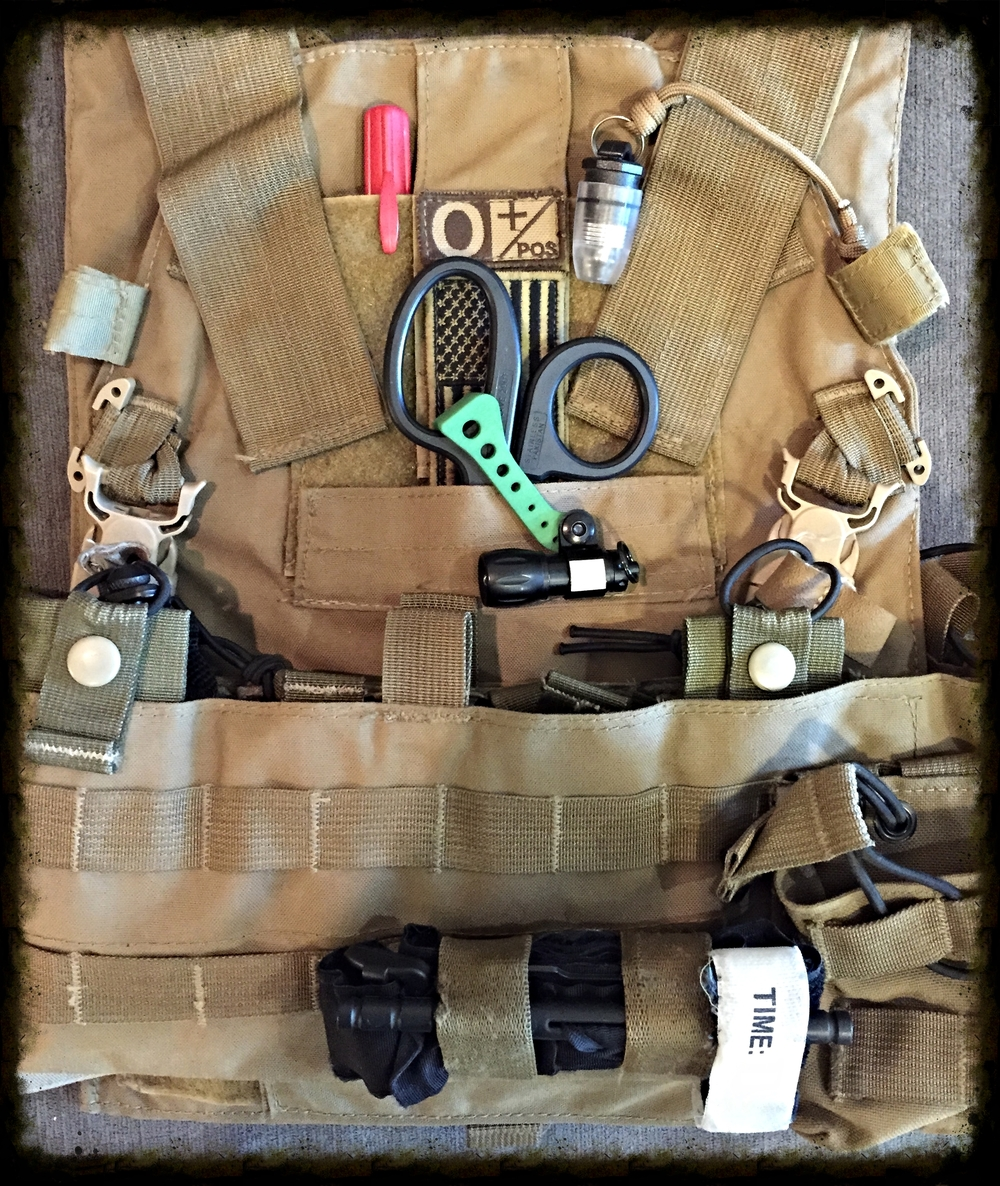 Primary tourniquet setup on kit, with secondary tourniquet located in a magazine pouch.