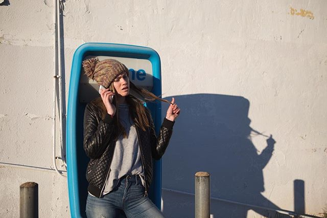 @haydanno has let me drive her around to random locations and photograph her for nearly eight years. I don't share enough of the images, so here's a favorite from a while ago. We thought we were so clever with a cell phone at a pay phone.