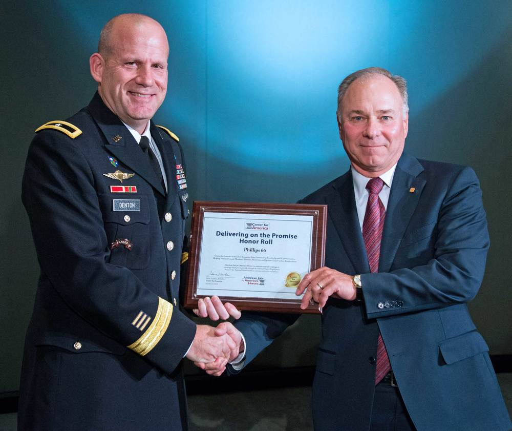 Brigadier General Ivan Denton presents the CFA Award to Larry Ziemba, Executive Vice President, Phillips 66