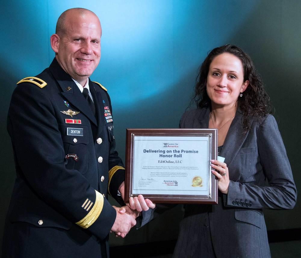 Brigadier General Ivan Denton presents the CFA Award to Angela Caban, Marketing Specialist, Ed4Online
