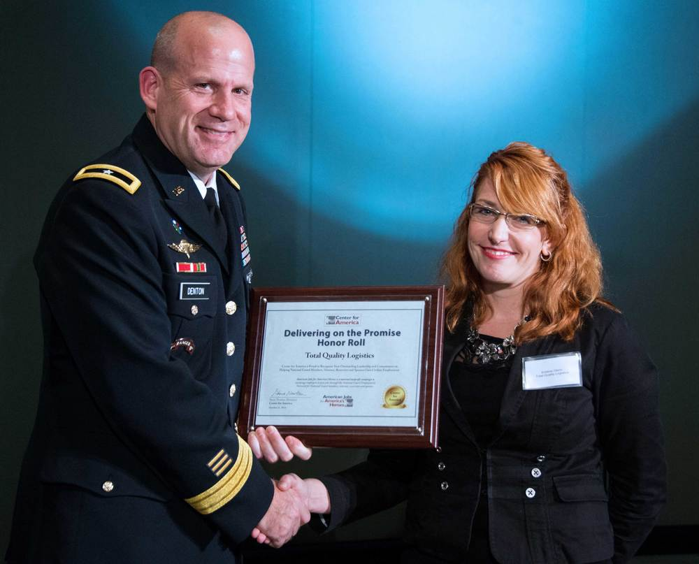 Brigadier General Ivan Denton presents the CFA Award to Kristine Glenn, Senior PR Specialist, Total Quality Logistics