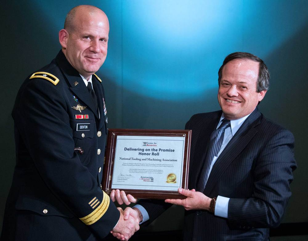 Brigadier General Ivan Denton presents the CFA Award to Paul Nathanson, Public Affairs Representative, National Tooling and Machining Association